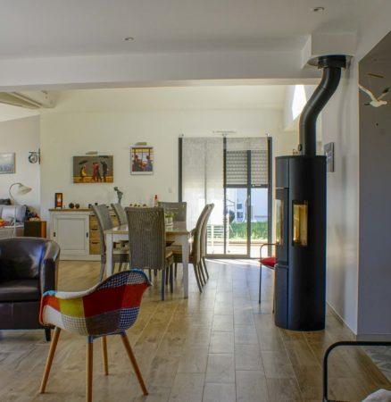 Aménagement et décoration d'un séjour d'une maison neuve sur plan avant construction
